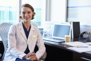 71352956 - portrait of female doctor wearing white coat in office