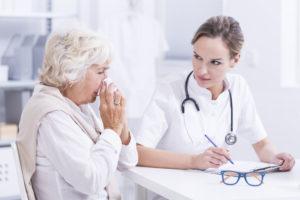 doctor speaking with eldery woman